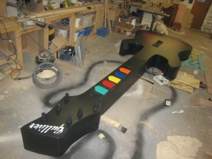Large scale Guitar Hero Guitar, with printed vinyl surface and interactive push buttons.