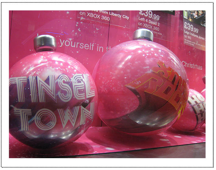 Baubles - HMV - round in window