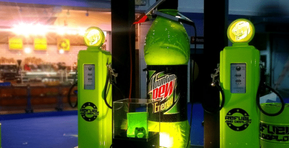 """Our exhibition stand for Mountain Dew included a giant Mountain Dew bottle and interactive """"fuel pumps"""" which dispensed Mountain Dew product for the ultimate interactive, experiential sampling activity."""